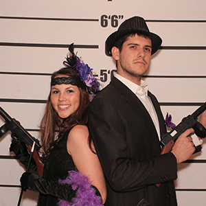 Tampa Murder Mystery party guests pose for mugshots